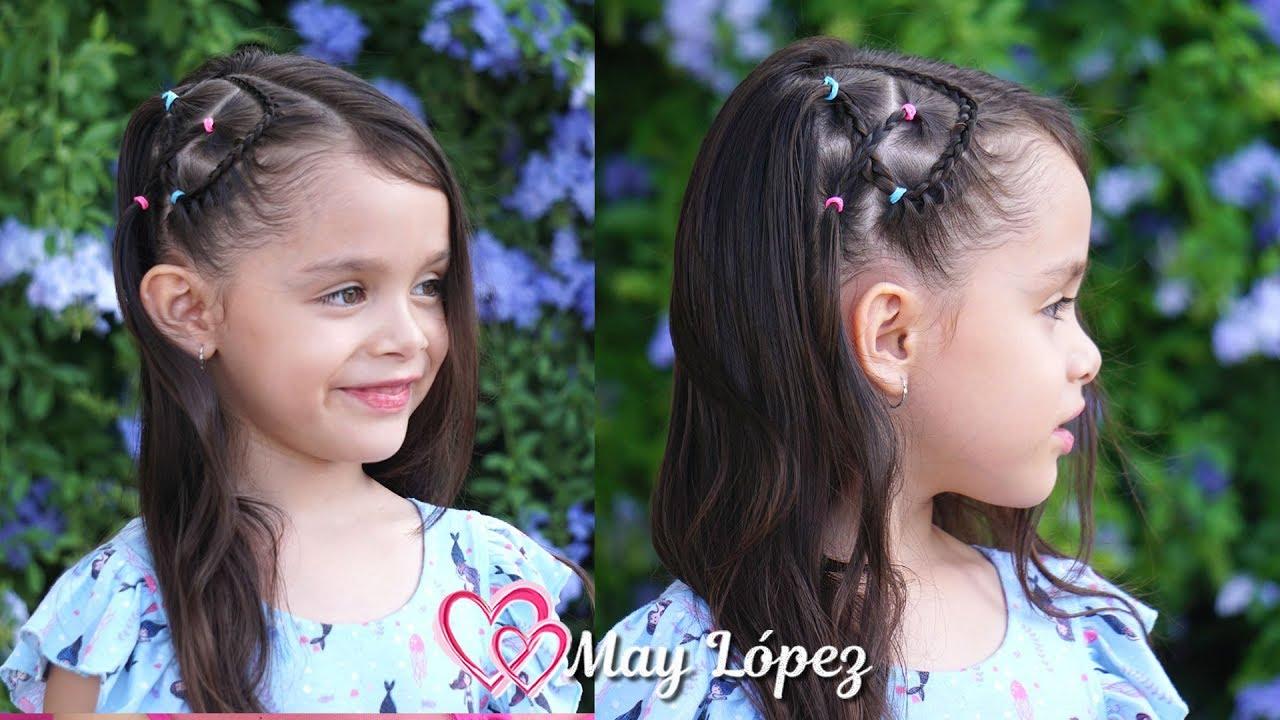 Hermoso peinado con ligas, trenzas y pelo suelto para niñas